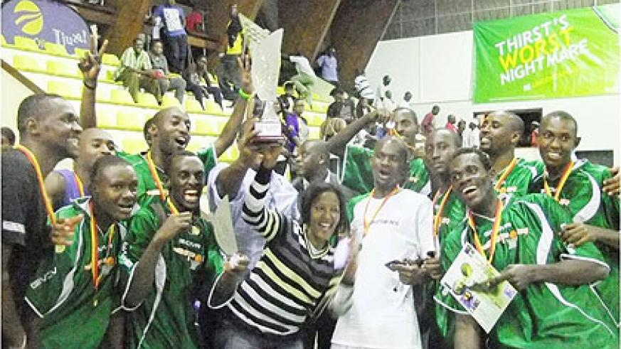 The National basketball league champions, Espoir celebrating their title recently. The New Times / File.