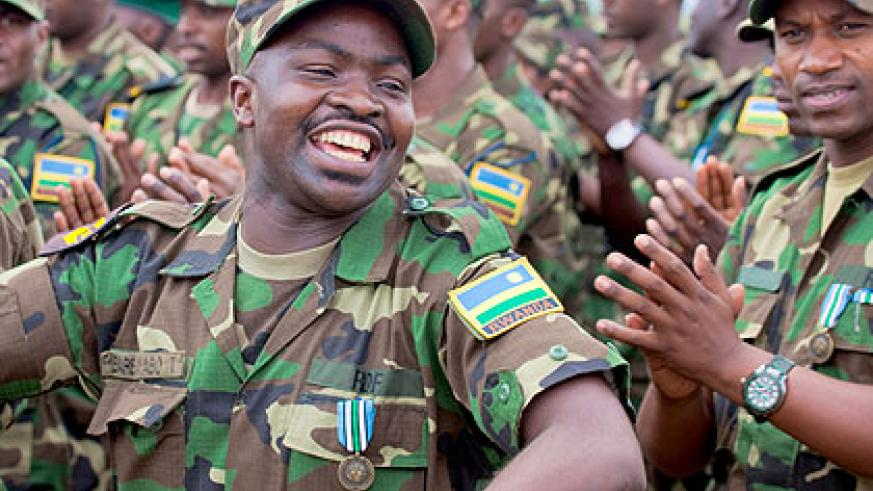 RDF soldiers sing after returning from South Sudan yesterday. The New Times/ Timothy Kisambira.