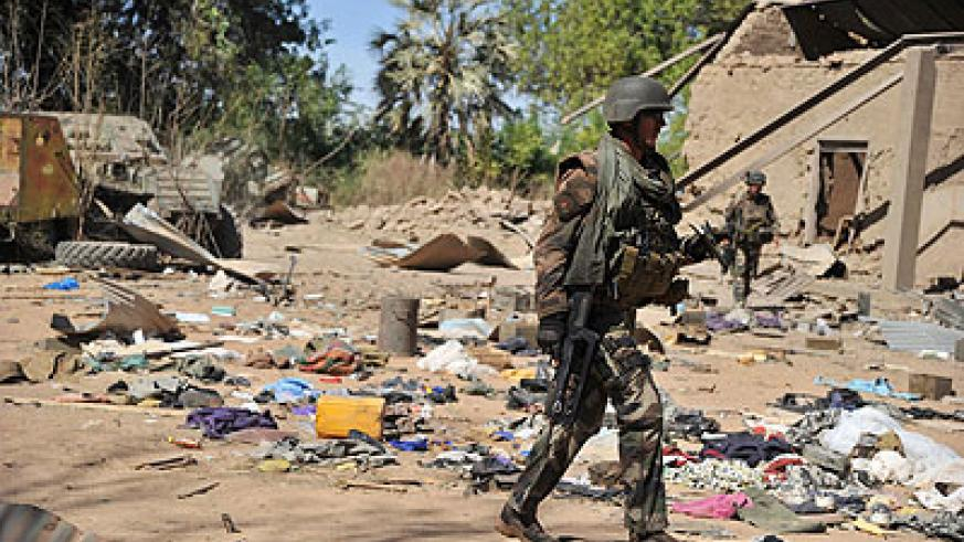French soldiers walk around an area destroyed during aerial bombings as they arrive in the city of Diabaly, on January 21, 2013: Gao was back under government control after clashes ear....