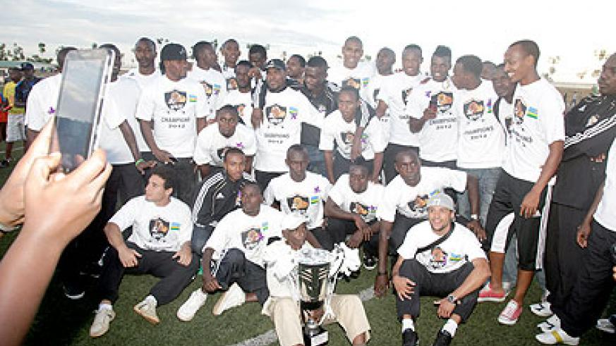 APR players celebrate after winning the Peace Cup last year. The New Times / T. Kisambira.