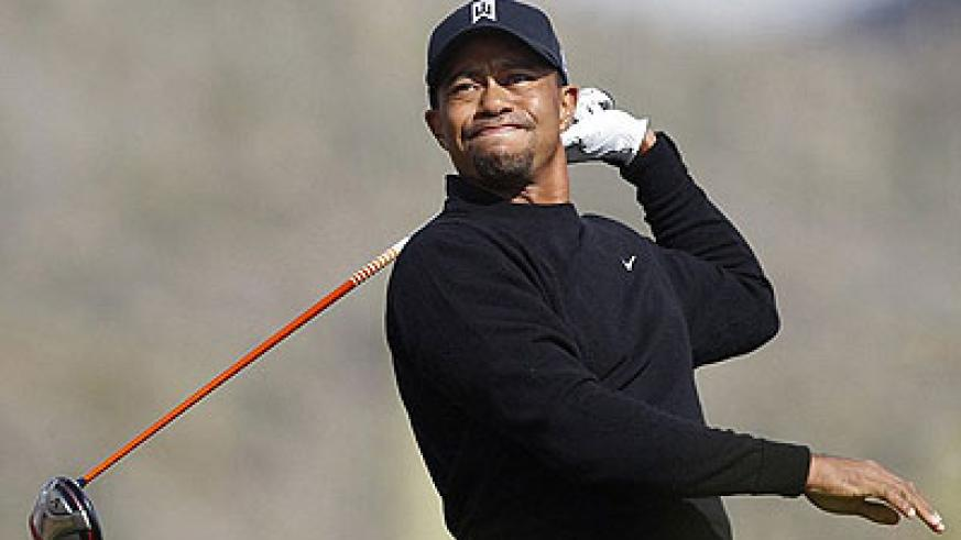 Tiger Woods had a poor day at the office, skewing this drive off target. Net photo.