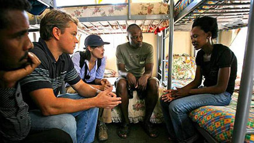U.S. actor Matt Damon meets Sharon Ruzvid, 18, a Zimbabwean refugee who was raped whilst pregnant, during his visit to the South African border town of Musina in Zimbabwe Tuesday, Marc....