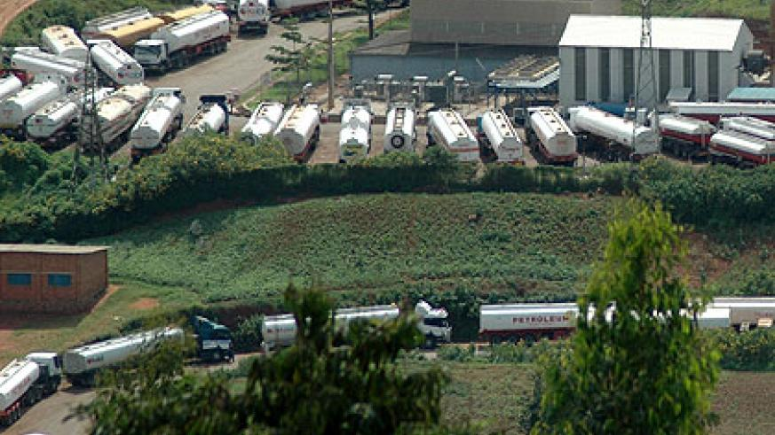 Trucks deliver fuel to the National Reserve in Gatsata.  The New Times/File.