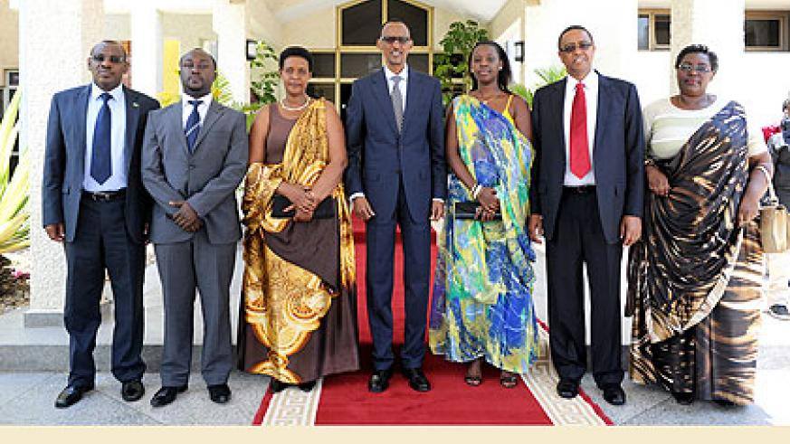New ministers (From left to Right) Amb. Gatete, Imena, Gasinzigwa, Dr. Asiimwe, Prof. Lwakabamba and Mukantabana with President Kagame after swearing in yesterday. The New Times/Villag....