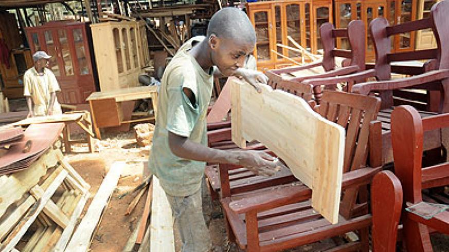 A lad at work in a furniture workshop in Gikinjiro. Youth in the country still face many challenges in contributing to nation building.  The New Times/ J. Mbanda.