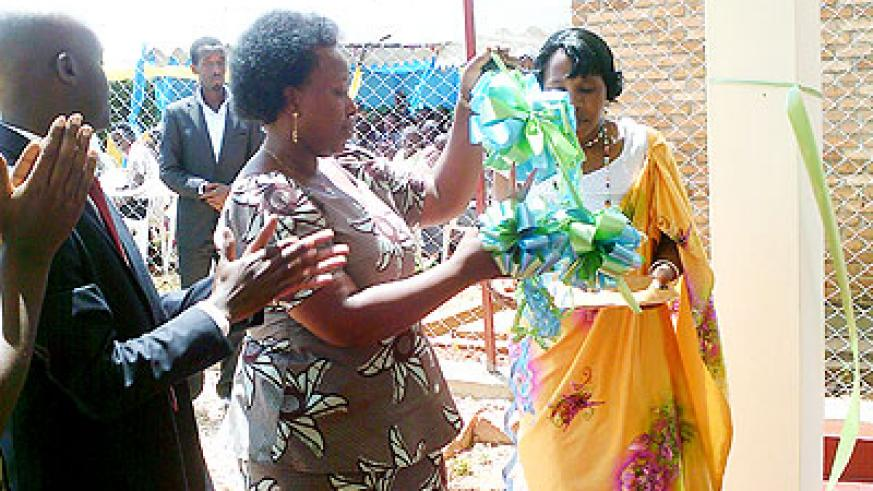 Mutakwasuku commissions the Muhanga Sacco office on Monday.  The New Times/ J. Mukamana.
