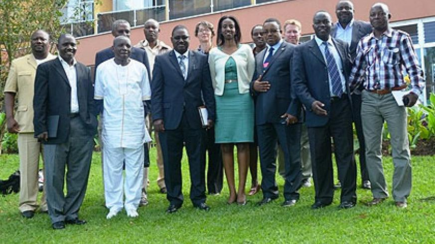 Some of the regional officials who participated in the meeting pose for photo. The New Times/ S. Nkurunziza.