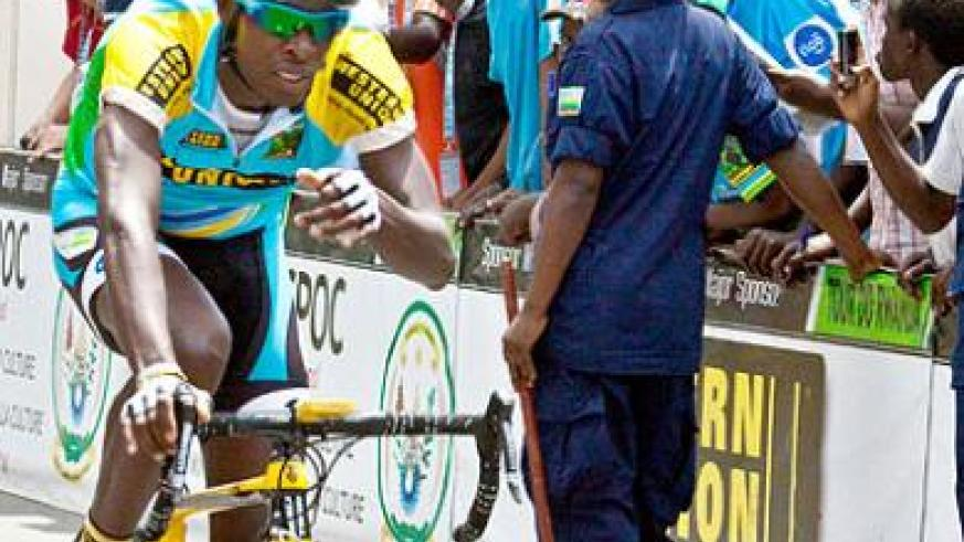 DOWN AND OUT; Adrien Niyonshuti, seen here competing in the 2012 Tour du Rwanda, will miss the rest of the season with a complicated illness.  The New Times /  T. Kisambira.