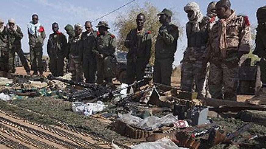 Mali soldiers display ammunitions seized from Islamist fighters on February 24, 2013.  Net photo.