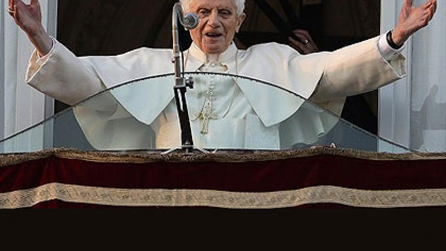 Pope Benedict XVI greets the crowd from the window of the Pope's summer residence of Castel Gandolfo, where he will spend his first post-Vatican days. Net photo.