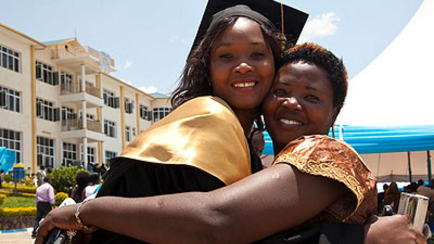 A mother congratulates her daughter upon her graduation.  The New Times/ Timothy Kisambira.