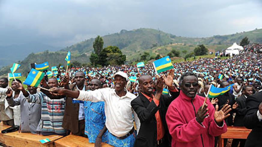 Nyamagabe residents welcome President Kagame (not in photo) in the Southern Province on February 19, 2013.  Debate has been heated over anticipated  change of leadership in 2017. Satur....