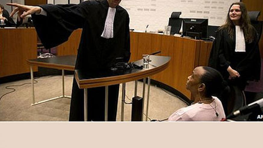 Basebya (seated) during one of the court hearings. Net photo.