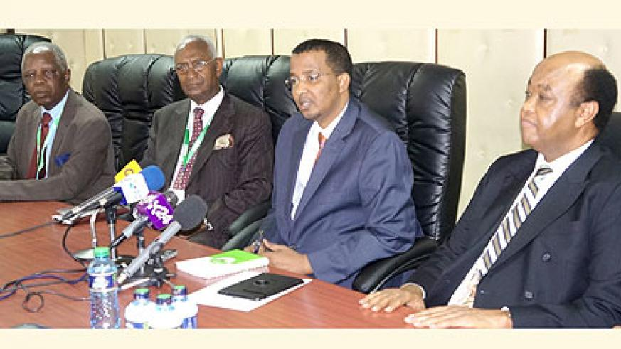 Hassan (C) addresses the media, yesterday, flanked by Abdulrahman Kinana (L), the head of EAC observers, and Veke Mubako of Comesa. The New Times/ Courtesy.