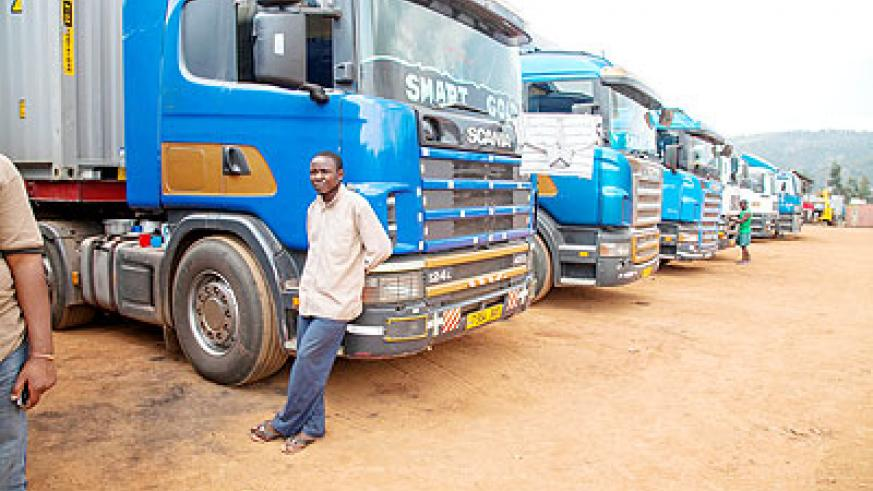 Trucks parked at Magarwa. Drivers are wary of how Kenya polls could turn out.  The New Times/ J. Mbanda