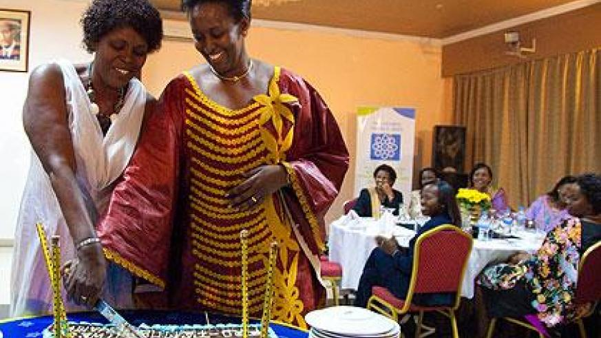First Lady Jeannette Kagame (R) with  Pro-Femmes Twese Hamwe Chairperson Jeanne d'Arc Kanakuze, cut the cake to mark the 20th anniversary of the organisation.  Sunday Times/T. Kisambira.
