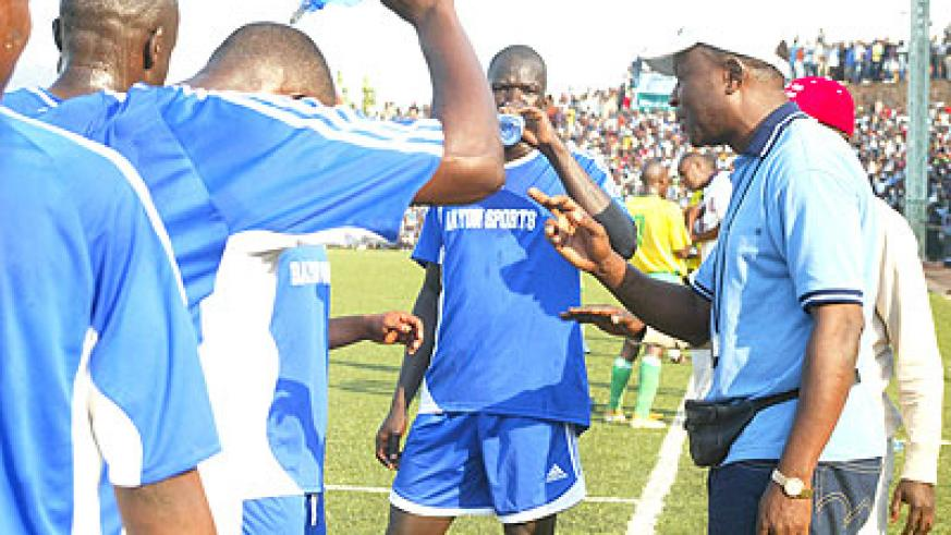 Raoul Shungu (right), seen here giving instruction to Rayon players during a Peace Cup match against Atraco in 2008. He took Rayon to Fifa over unpaid arrears. The New Times / File.