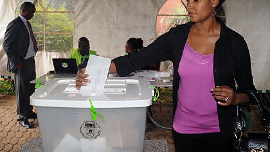 A voter casts her vote at the Kenyan High Commission in Kigali yesterday. Kenyans took to the polls to vote for a new leader to replace outgoing President Mwai Kibaki. By press time,  ....
