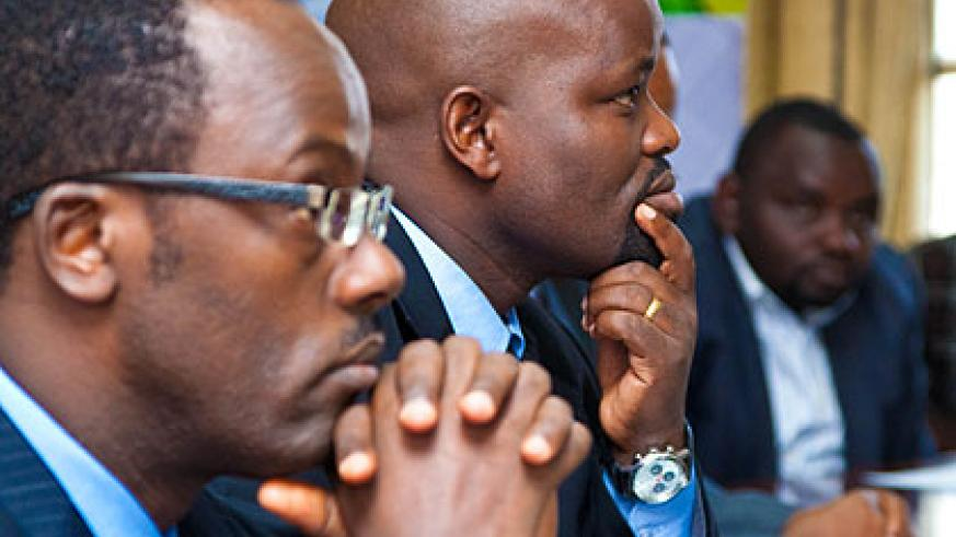 Ndayisaba (L) and Nsengimana listen to a presentation   The New Times/ Timothy Kisambira.