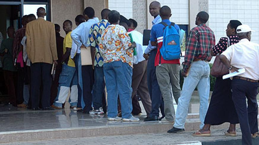 Clients queuing at RRA head offices to pay taxes. The body is calling on businesses in the Northern Province to clear their arrears. The New Times/ File.