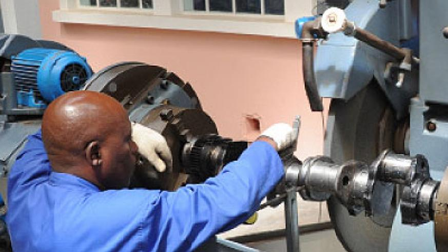 An engineer operates machinery in a factory in Kigali recently. Local engineers can now spread their expertise across the region after a treaty was amended to absorb Rwanda and Burundi....