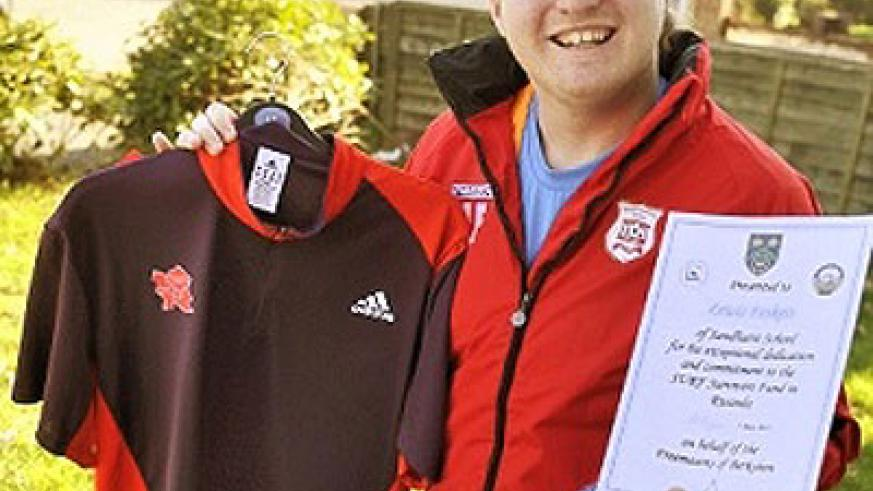 Lewis Foskett from Sandhurst is raising money for his football coaching trip to Rwanda by selling an Olympic shirt signed by double gold medallist Mo Farrah. Net photo