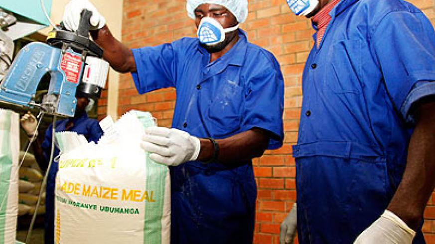 Workers packing maize at Minimex. Agro-processors want to strengthen their presence in Burundi The New Times/Timothy Kisambira.