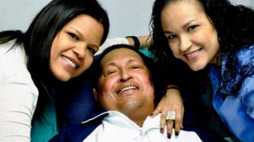 Venezuelan President Hugo Chavez poses for a photo with his daughters, Maria Gabriela, left, and Rosa Virginia at an unknown location in Havana, Cuba, Feb. 14, 2013. It was the last pu....