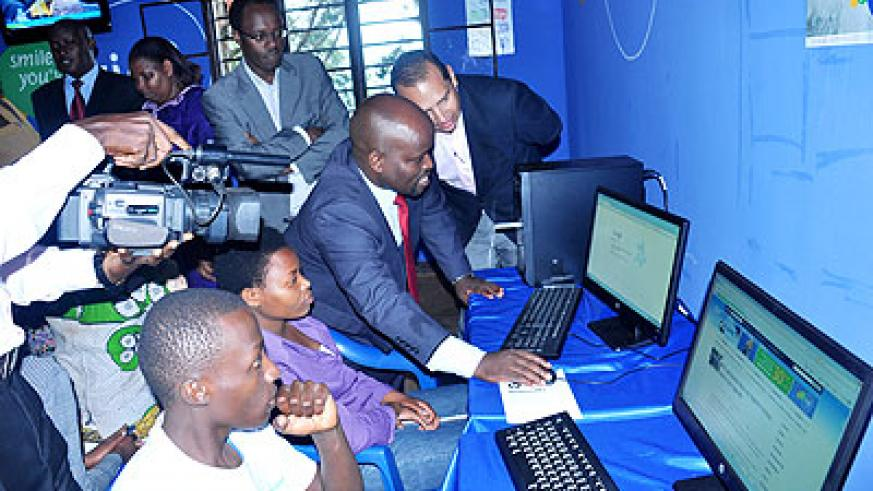 Nsengimana browses websites on one of the donated computers in Nyarurama cell, Kicukiro district, yesterday.  The New Times/ T. Kisambira.