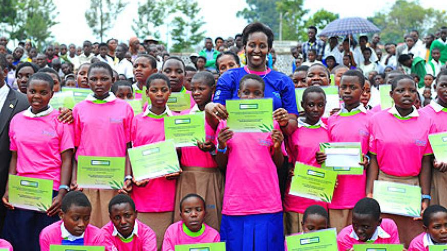 <p>The First Lady, Jeannette Kagame, poses with some of last year&rsquo;s best performing girl students. Mrs Kagame observed that, if girls are acquainted with the importance of dignit....