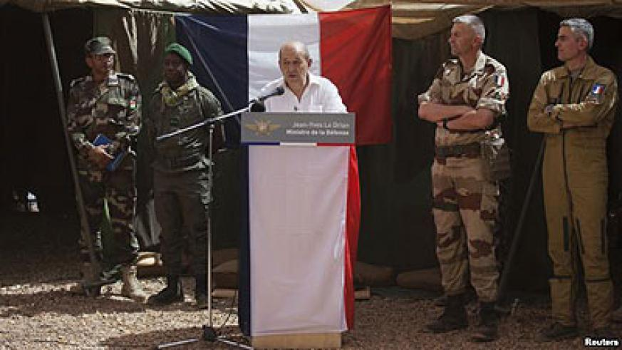 France's minister of defence Jean-Yves Le Drian (C) speaks to French troops in the northern Malian region of Ifoghas on March 7, 2013 .  Net photo.