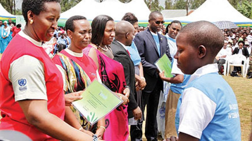 First Lady of Rwanda rewards a best performing girl in 2012 Girls Education campaign. The New Times/Courtesy.