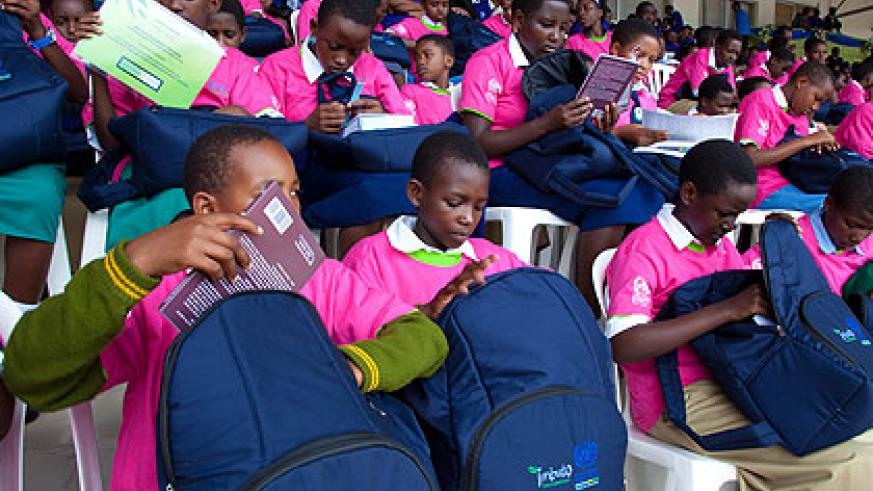 Some of last year's best performing girls check through gifts received from Imbuto Foundation yesterday. The New Times/ Timothy Kisambira.