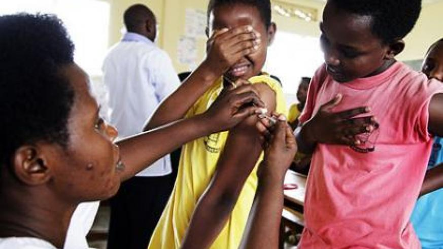 A medical practioner takes part  in a vaccination drive last year. Rwanda will be the first African country to roll out the measles and rubella vaccine countrywide, starting today.   T....