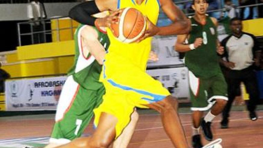 Lionel Hakizimana, seen here in action during a past youth international game against Morocco, will be a key player for Rwanda at the Afro-basket championships.. The New Times / File.