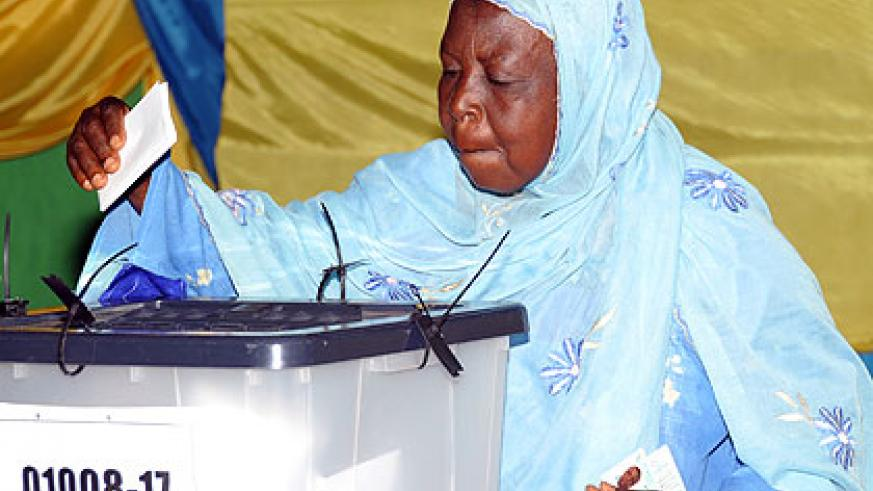 A voter casts her ballot during the presidential polls in 2010.  The New Times/ File.