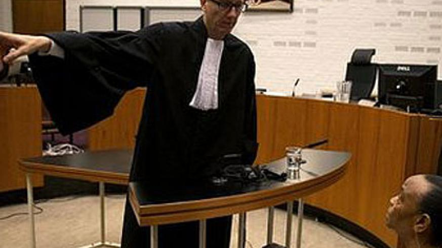 Basebya (sitting) during one of the court sessions in the Netherlands.   Net Photo.