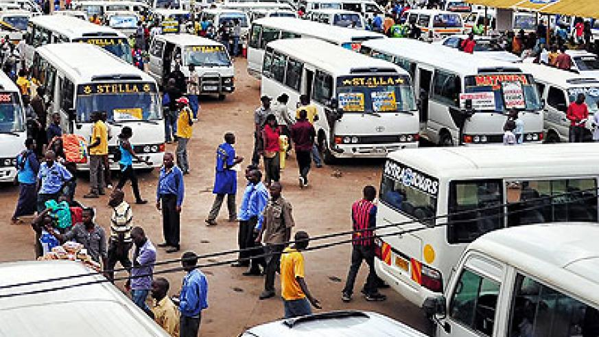 Modern buses and decrepit taxis side by side in Nyabugogo bus park. Net photo.