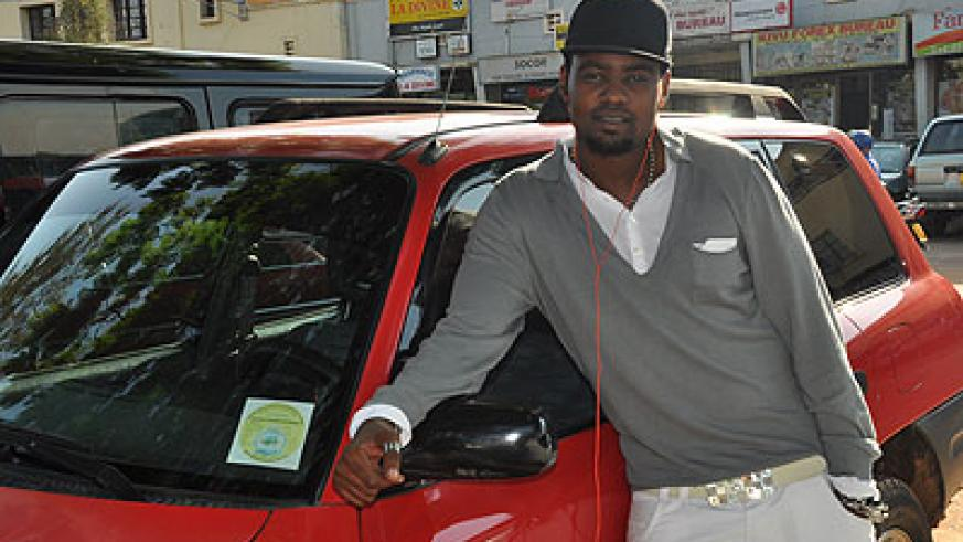 Kitoko standing besides his car. The New Times / File.