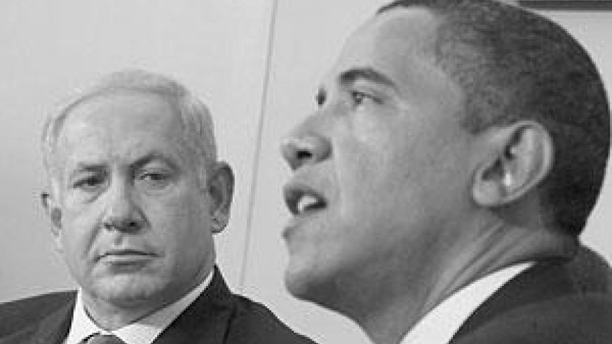 Israeli Prime Minister Benjamin Netanyahu, right, looks towards President Barack Obama as he speaks to reporters in the Oval Office of the White House in Washington. Net photo