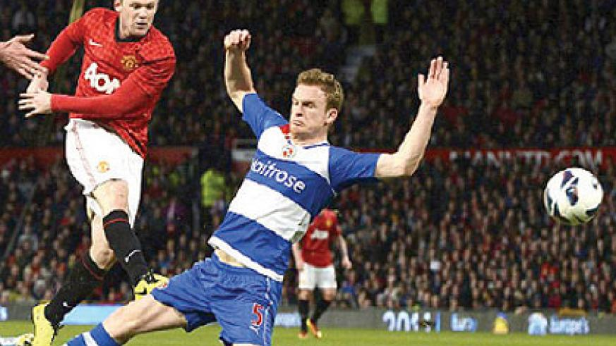 Rooney's shot took a deflection off Reading defender Alex Pearce before nestling in the net. Net photo.