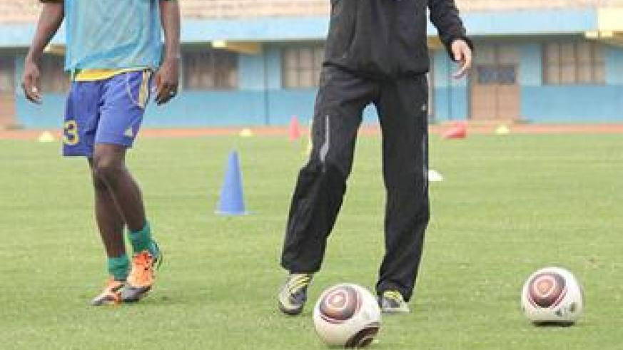Micho showing his defender Ismail Nshutiyamagara what to do during a past training session. The New Times / T. Kisambira.