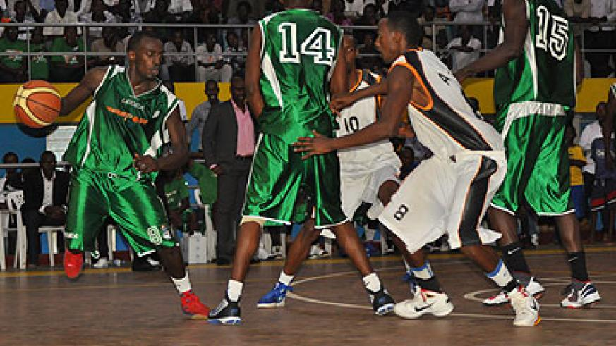 Espoir point guard Aristide Mugabe (left) tries to dribble past APR defence in the  second half of the Playoff final Game Three on Saturday. The New Times / Plaisir Muzogeye.