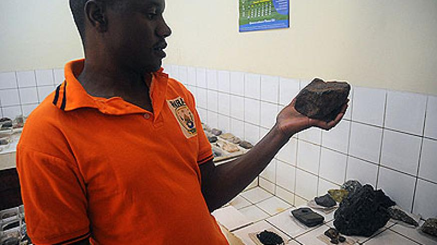 An official displays cassiterite ore.  Rwanda is looking to strengthen its mining industry to improve earnings. The New Times / John Mbanda