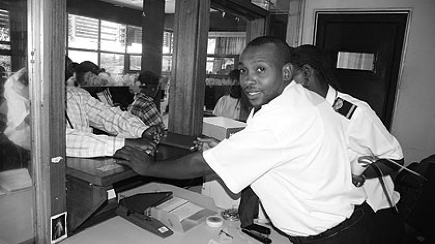 Customs workers attend to travellers. The EAC customs union implemented in 2005 has been sucessful.  Experts are urging caution on monetory union.