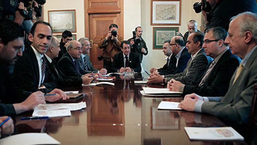 President Nicos Anastasiades (centre) holds talks with party leaders and central bank governor Panicos Demetriades (second right)..  Net photo.