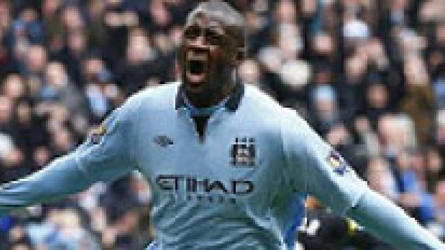 Manchester City's Yaya Toure celebrates his goal against Chelsea during their English Premier League soccer match at the Etihad Stadium in Manchester, Northern England.