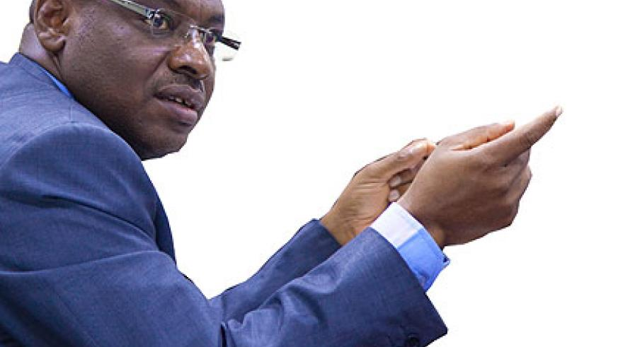 UPWARD: Amb. Gatete briefs journalists about the state of the economy yesterday.  The New Times/ Timothy Kisambira.