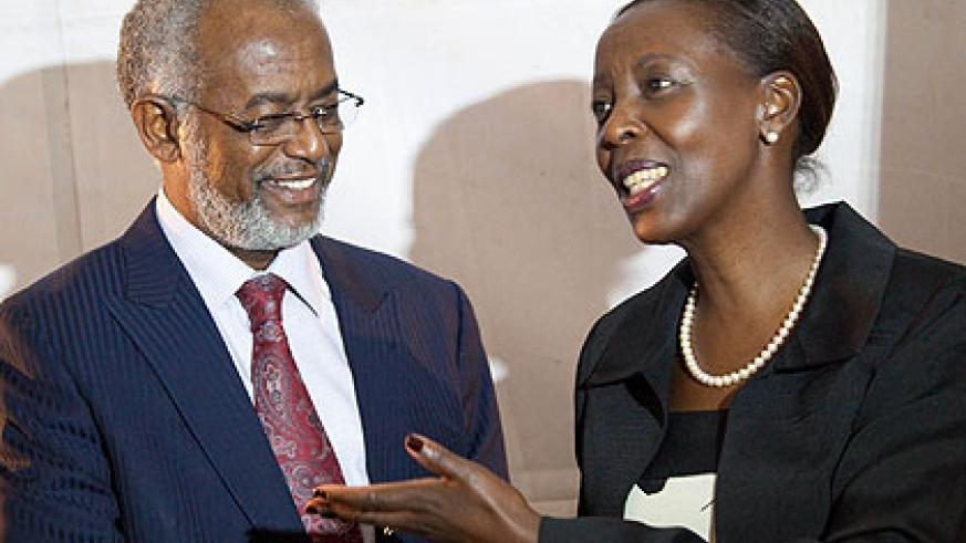 Mushikiwabo (R) with her Sudanese counterpart, Ali Ahmed Karti, in Kigali during the opening. The New Times/ Timothy Kisambira.