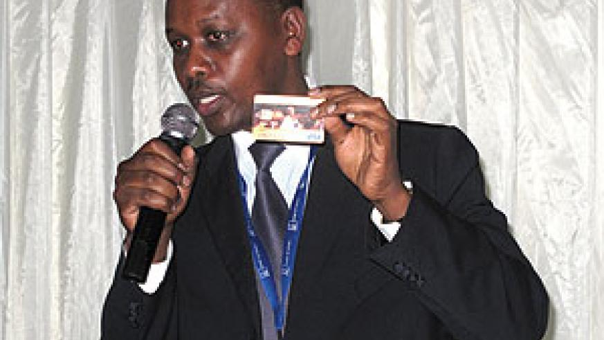 Ngunga displaying the Visa card at the meeting over the weekend. The New Times/ Stephen Rwembeho